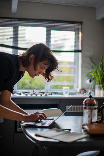 Woman seen using her computer at home
