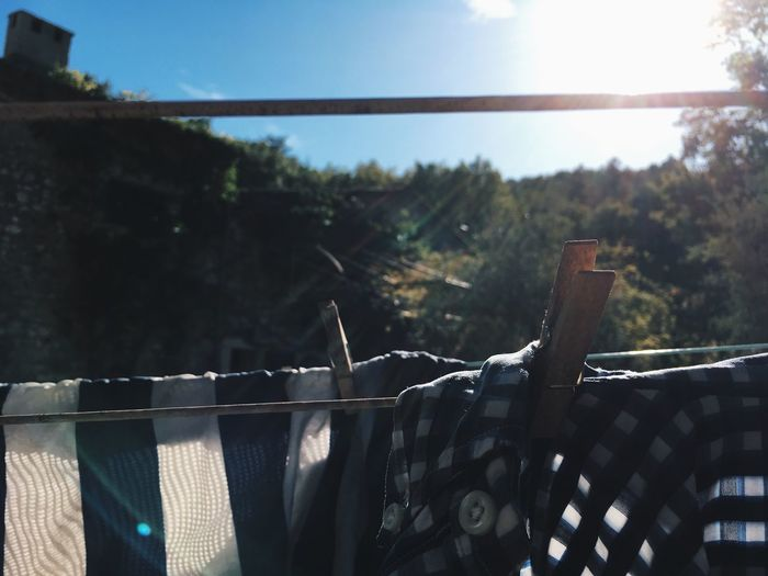 Clothes drying on railing against sky