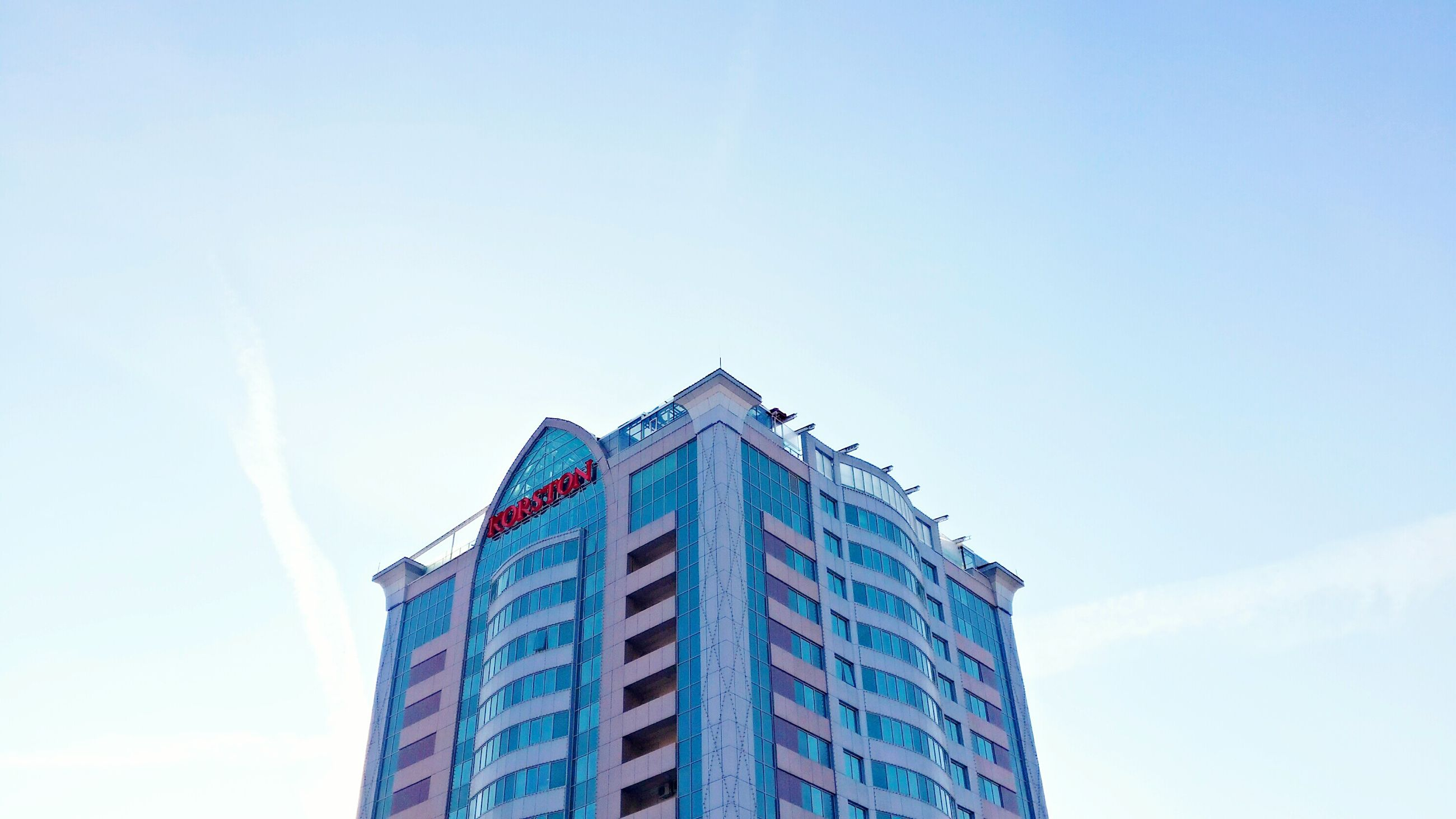 building exterior, architecture, low angle view, built structure, blue, clear sky, copy space, city, building, office building, modern, sky, high section, tower, tall - high, day, outdoors, skyscraper, no people, window