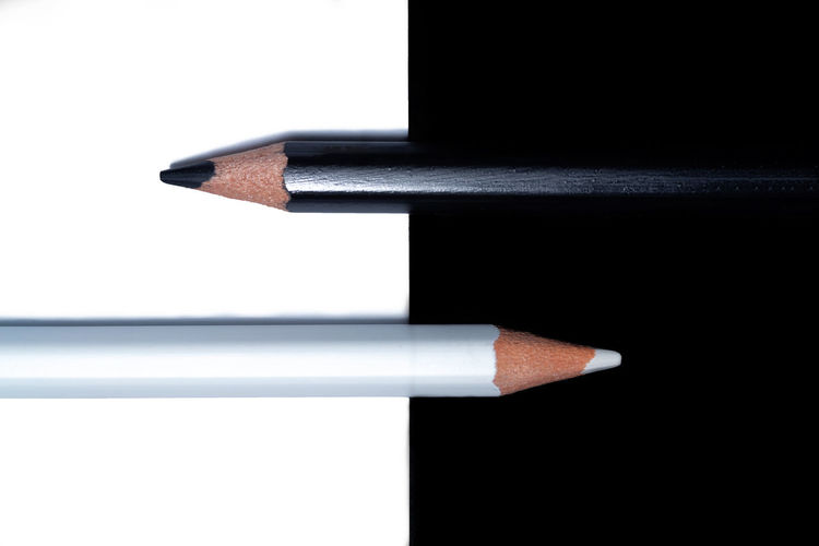 Directly above shot of pencils against white background