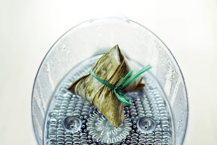 Bak Zhang Bak Zhang Chinese Food Zongzi Animal Celebration Close-up Directly Above Dumpling  Focus On Foreground Food High Angle View Indoors  Leaf No People Plant Part Rice Dumpling Selective Focus Still Life Studio Shot Table Two Objects White Background