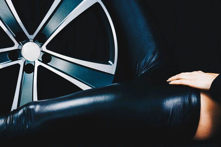 Female legs in latex uniform lying between car sport wheels. Adult Adults Only EyeEm Best Shots EyeEm Selects EyeEm Gallery EyeEmBestPics EyeEmNewHere Latex Dress  Eye4photography  Fetish Human Body Part Human Hand Indoors  Latex Latex Fetish One Person People Real People