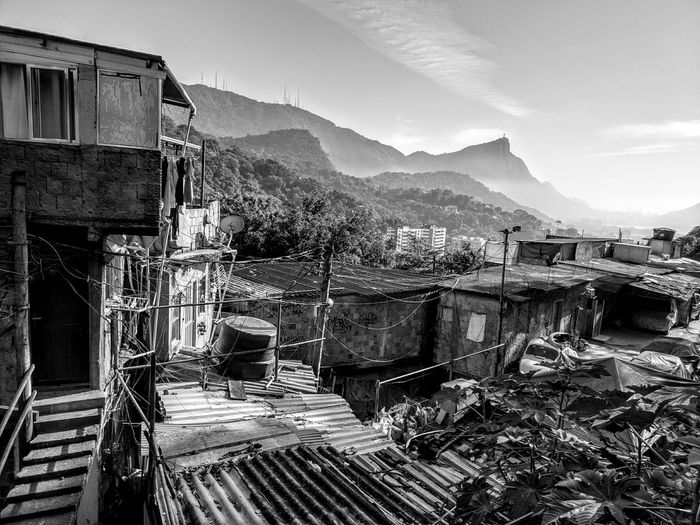 View of ruined houses against mountain