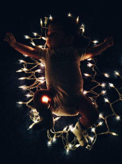 Boy playing with christmas lights