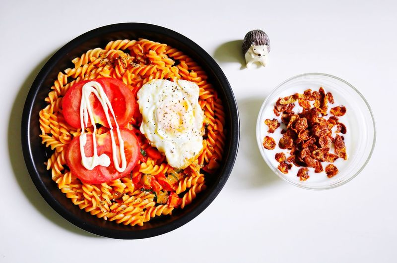 High angle view of pasta and cornflakes served on table