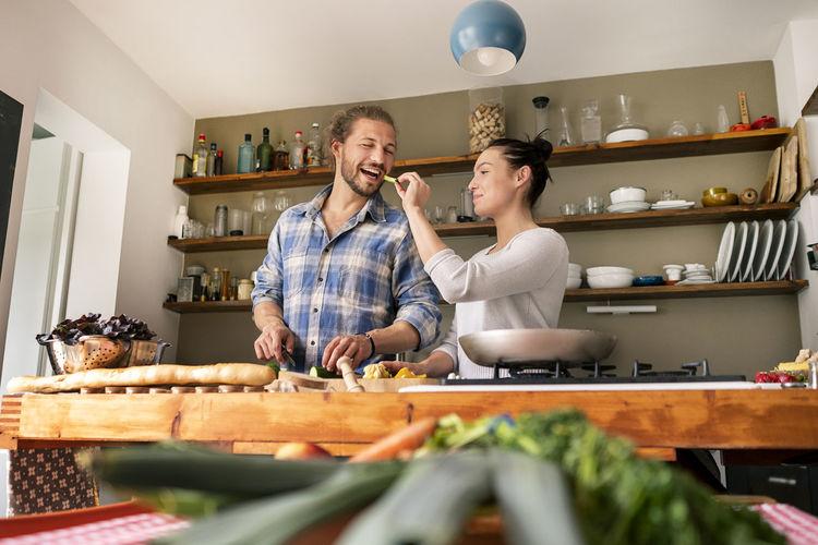 Man and woman having food