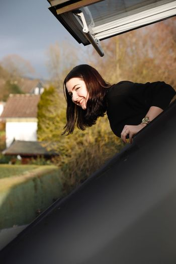 Portrait of smiling young woman on roof top