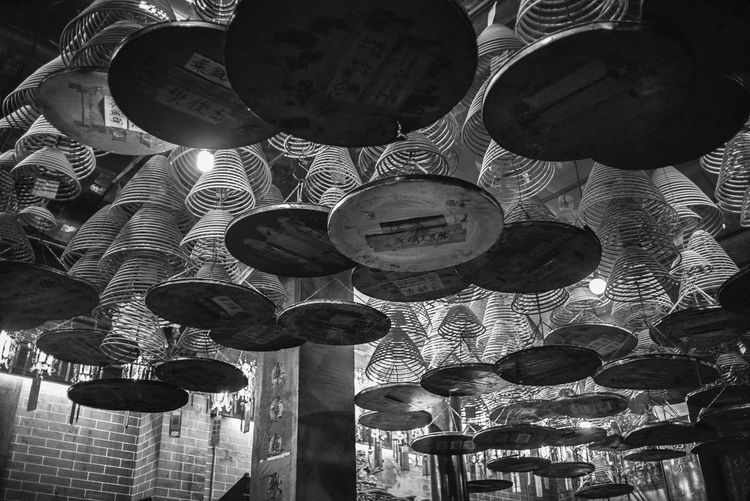 Low angle view of lanterns hanging on ceiling in building