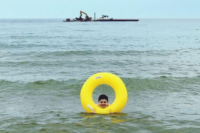 Water Sea Outdoors Nautical Vessel Horizon Over Water Kid Son Waterboy Innertube Yellow Yellowcircle Day Beach