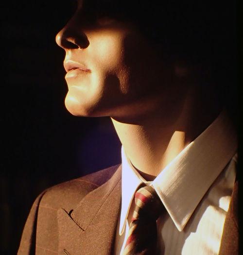 Sunlight falling on mannequin with necktie