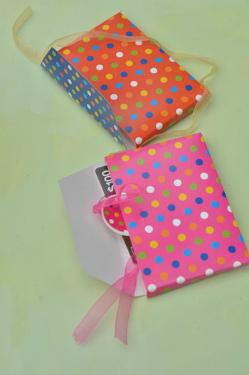 Close-up of colorful paper bags on table