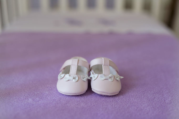 Tiny baby shoes for christening day Baby Bows Babygirl Babyhood Celebration Christening Day Close-up Event Life Events No People Pair Pink Color Purple Selective Focus Shoe Still Life Textile