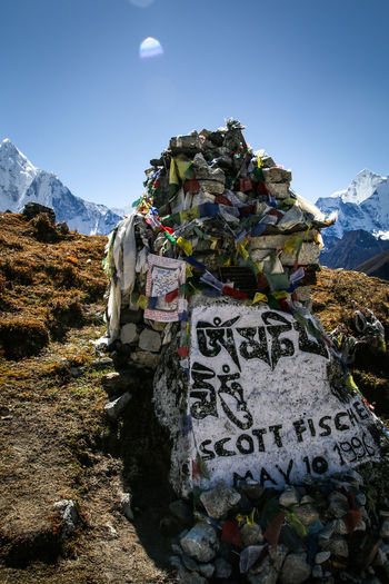Khumbu Himalaya Memorial Rob Hall Scott Fisher Beauty In Nature Communication Day Environment Everest Himalaya Information Landscape Memory Mountain Mountain Range Nature No People Non-urban Scene Outdoors Prayer Flags  Praying Rock Scenics - Nature Sky Text The Traveler - 2018 EyeEm Awards