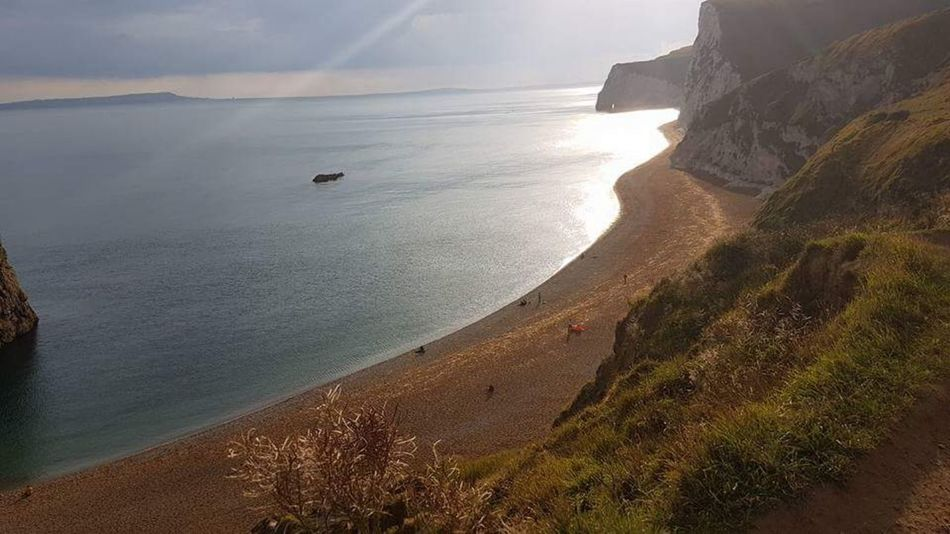 Durdle Door in Dorset,UK Water Wave Sea Nautical Vessel Beach Low Tide Sand Dune Sand Sunset Swimming Seascape Surf Coastal Feature Coastline Crashing Rushing Shore Coast Tide Headland Rocky Coastline Surfing Horizon Over Water