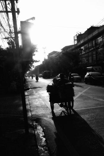 Street Transportation Road City Sunlight Rideing Poorpeople Lifestyles Working Hard Black Blackandwhite Asian  Bangkok Thailand.