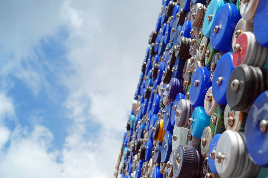 bottlebeach 5050 Abundance Art Australia Blue Bluesky Bottle Art Bottle Top Close-up Day Halfhalf Large Group Of Objects Lids Low Angle View No People Outdoors Perspective Photography Sky Streetart Sydney Australia Sydney Photography Trashart Upcycling