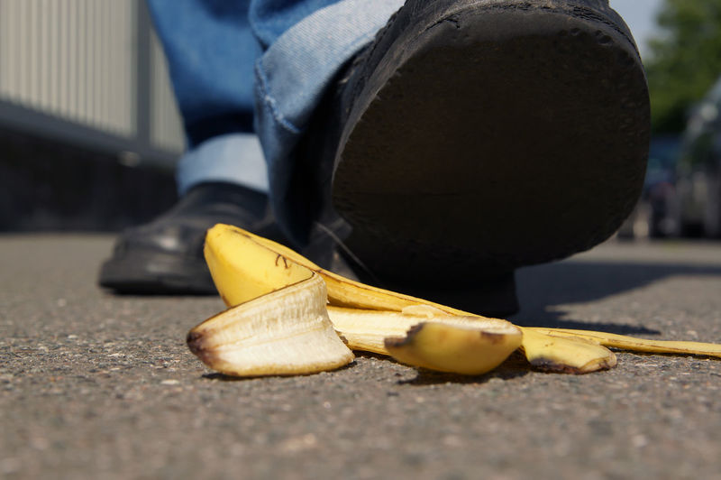 Accident Accident Waiting To Happen Banana Banana Peel Banana Skin Close-up Danger Discarded Foot Footpath Ground Outdoors Selective Focus Shoe Slippery Slipping Slipping On Banana Peel Sole Surface Level