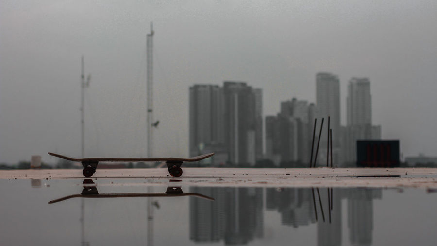 Tall buildings against sky with waterfront