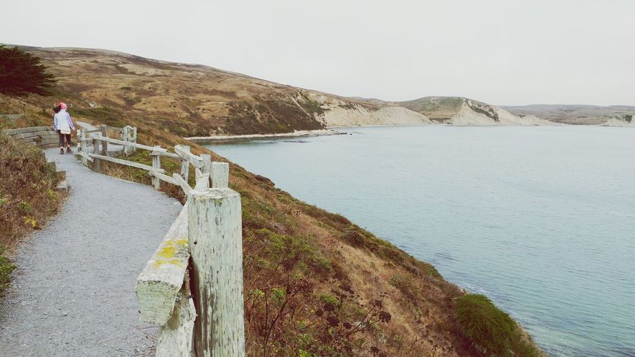 Don't look down. Edge Of The Ocean Rocky Coastline Point Reyes, California Hills And Ocean Bluffs And Fog Alone By The Ocean Woman Walking Along The Cliff Foggy Landscape Hills Blanketed In Fog Finding New Frontiers Miles Away Breathing Space
