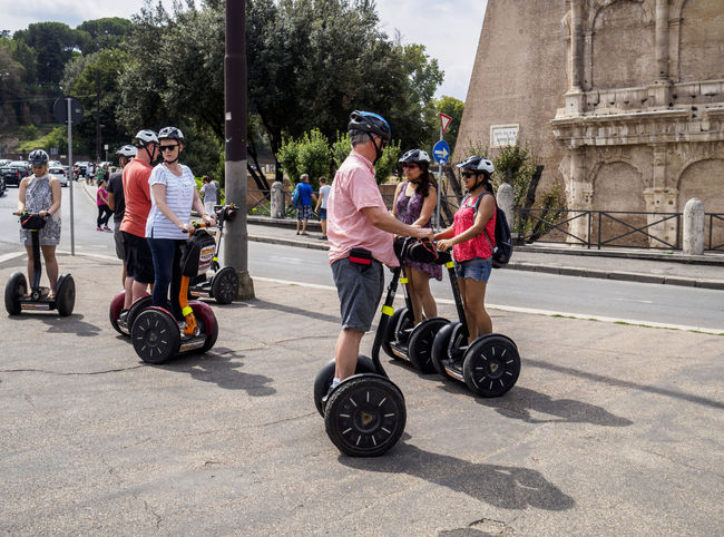 People doing things in Rome Italy Segway tourists City Life Italy Lifestyles Person Rome Segway Tour Tourism Tourist Transportation