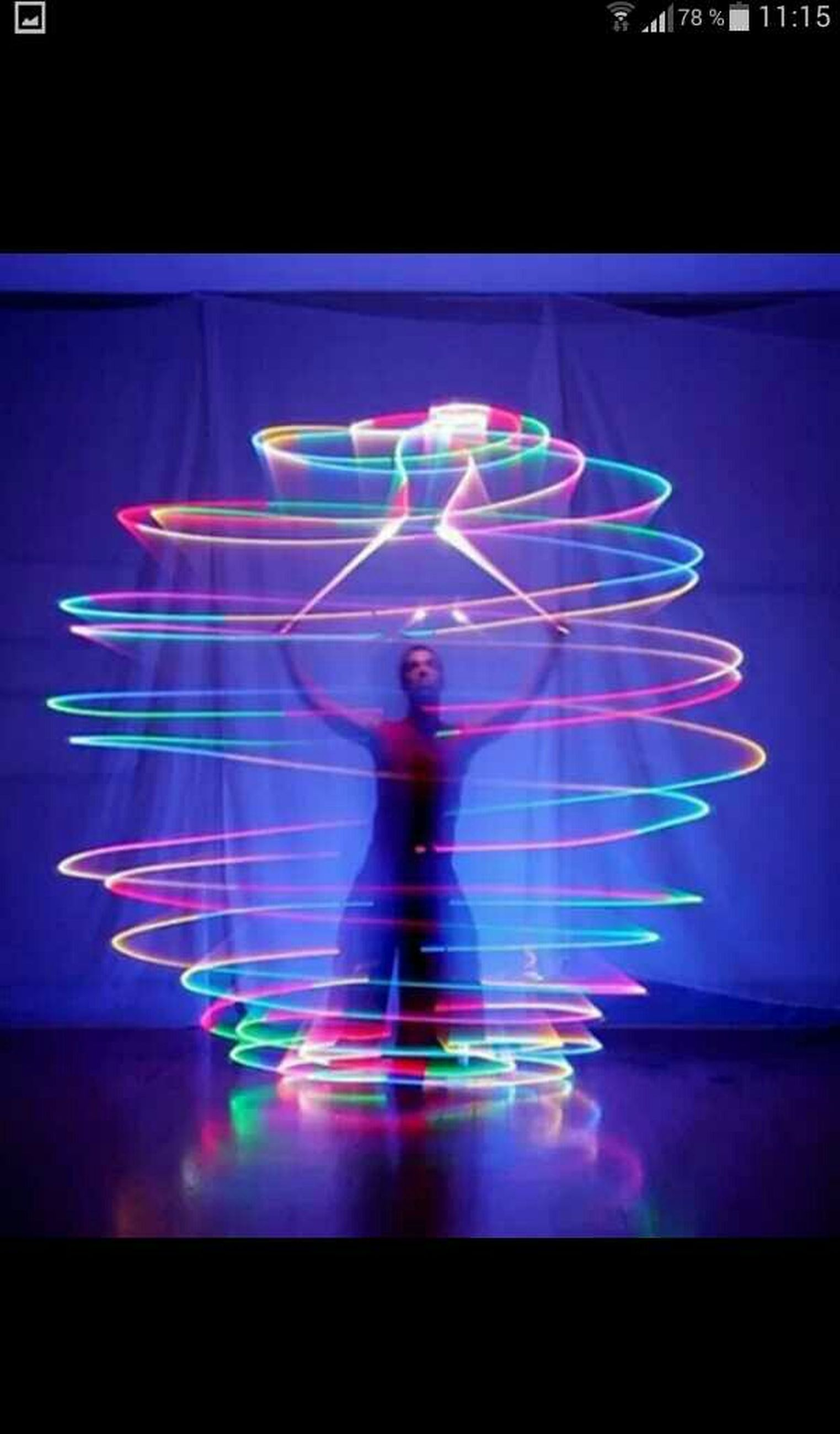 leisure activity, lifestyles, indoors, illuminated, full length, arts culture and entertainment, night, standing, enjoyment, reflection, motion, fun, water, rear view, men, blue, holding, multi colored
