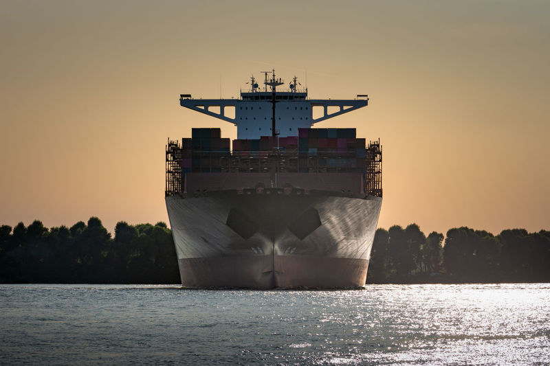 Turning manoeuvre at sunset of a container ship