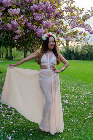 Beauty in nature Asian model from the Philippines in a park with a sheer drees bikini on . Beautiful Girl Beautiful Model Blooming Blur Background Cherry Blossom Day Daylight Flowers Grass Modeling One Person Outdoors Outdoors Photograpghy  Outside Plants Portraits Pretty Girl Taking Photos Tree