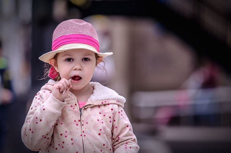 Childhood Mouth Open Innocence Front View Focus On Foreground Cute One Person Outdoors Pink Color Baby Portrait Day Girls Real People Child People Lollipop Facial Expression Candy