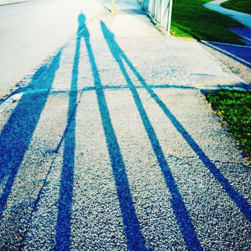 Shadows of two people EyeEm Selects Summer Shadow Sunlight Road Grass Long Shadow - Shadow Focus On Shadow Asphalt Paved