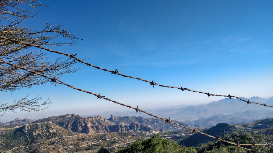 View of barbed wire against sky