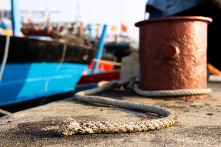 Tie the rope with it. Huế Tranquility Vietnam Bay Boat Close-up Countryside Dock Estuary Fishing Boat Fishing Industry Focus On Foreground Harbor Lake Moored Nature Nautical Vessel No People Outdoors Port Rope Selective Focus Tranquil Scene Water Wharf