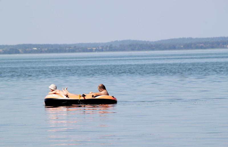 father and son on a small boat in Poland Baden Blue Boat Father And Son Freizeit Holiday Idyllic Má Nature Nautical Vessel P Schlauchboot Selfie Tourism Tranquil Scene Tranquility Trust Vacations Vertrauen Water Waterfront