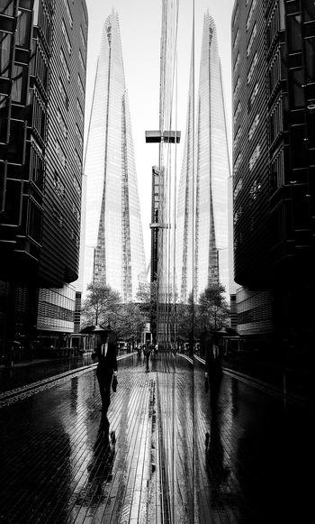 People walking on modern buildings in city