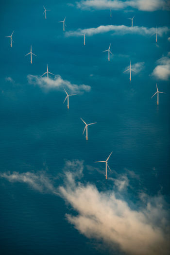 Aerial view of windmills on land