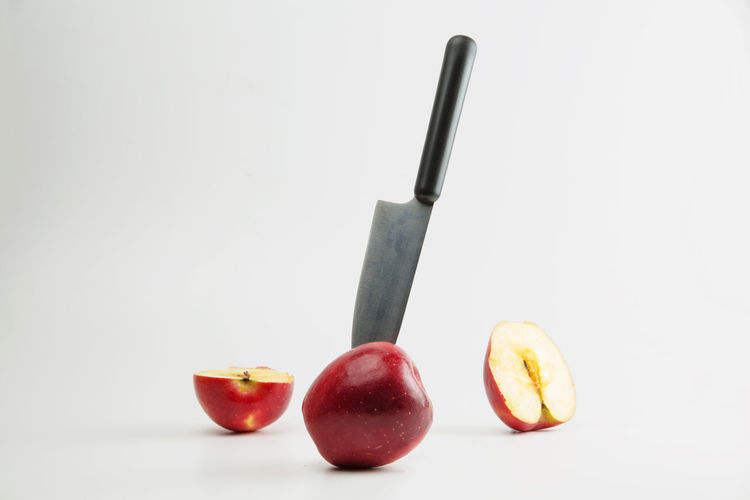 Food And Drink Food Fruit Healthy Eating Freshness White Background Still Life Wellbeing Indoors  Apple - Fruit Studio Shot Copy Space Kitchen Knife Close-up Red No People Cut Out Group Of Objects SLICE Three Objects Orange Temptation