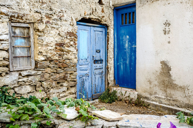 Detail of abandoned house in Lefkes, Paros, Greece Façade Paros Ruins Wood Abandoned Architecture Blue Building Exterior Built Structure Cyclades Door Doorway Entrance Greece House Lefkes No People Old Old-fashioned Outdoors Stone Stone Wall Weathered Window
