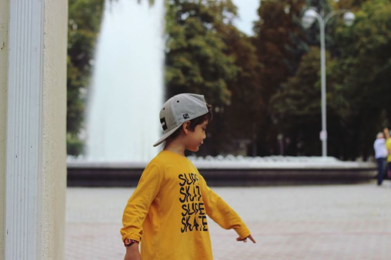 EyeEm Selects One Person Lifestyles Focus On Foreground Day Leisure Activity Standing Real People Child Childhood Clothing Casual Clothing Waist Up Yellow Outdoors Men Looking Away Text Boys Side View Autumn Mood