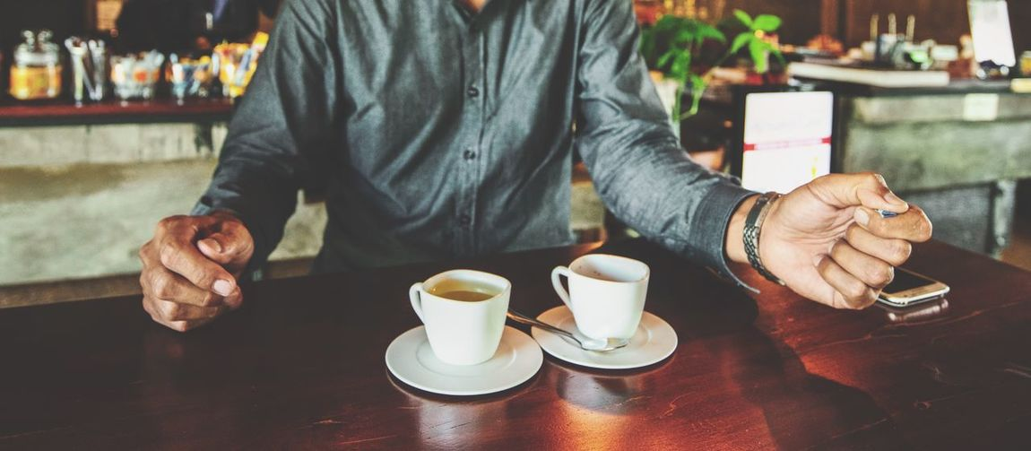 Man drinking a cup of coffee in the cafe Panorama Coffee Shop Cafe Drink One Person Food And Drink Cup Coffee Table Cafe Real People Coffee Cup Coffee - Drink Refreshment Mug Lifestyles Hand Men Holding Human Hand