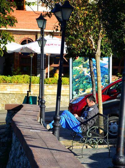 Man sleeping in front of building