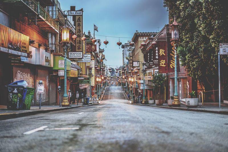 Empty street amidst buildings at dusk