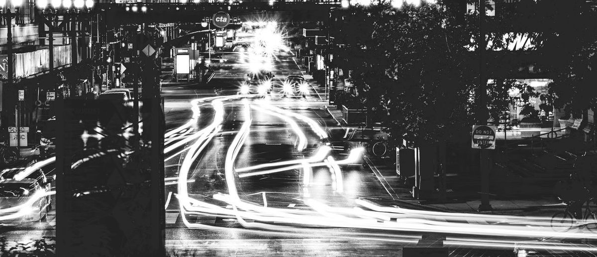 Long Exposure B&W in downtown Chicago Blurred Motion Building Exterior Car City City Life City Street Illuminated Light Trail Long Exposure Motion Night No People Outdoors Road Speed Street Street Light Traffic Transportation