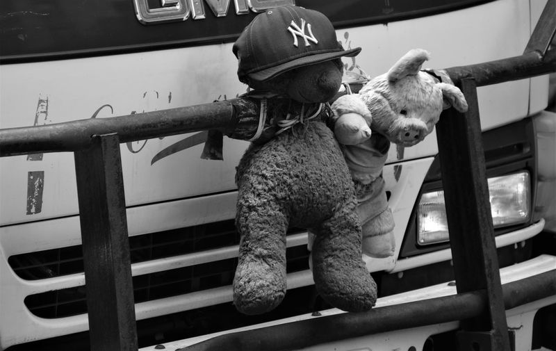 Moment from Manhattan The Street Photographer - 2018 EyeEm Awards Black And White Close Up Dirty Front Truck With Toy Good Luck Charms Stuffed Toy Stuffed Toys On Truck Truck
