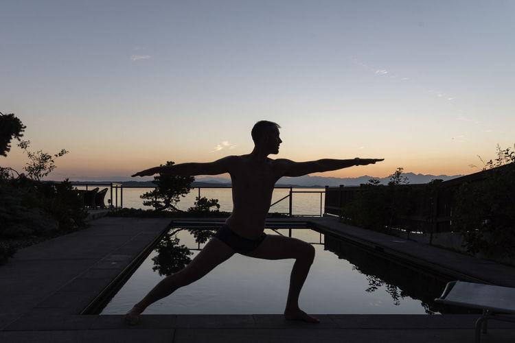 Man Doing Yoga During Sunset