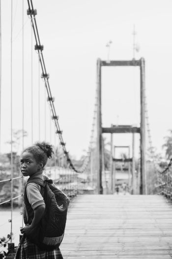 Choco Nuquí Colombia Pacific Coast Bridge Hanging Bridge Girl School Uniform Black And White Streetphotography One Person People Young Adult Outdoors People Watching Travel Portrait School Girl Traveling Uniqueness Women Around The World EyeEm Diversity The Street Photographer - 2017 EyeEm Awards The Portraitist - 2017 EyeEm Awards Connected By Travel Black And White Friday This Is Latin America