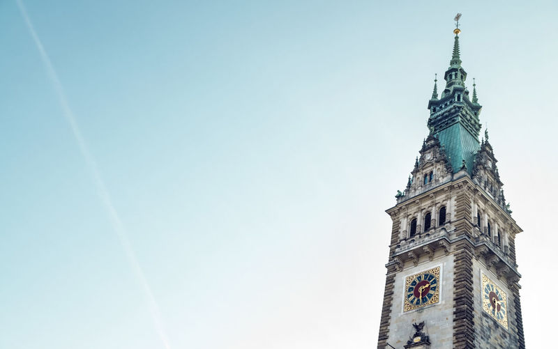 Hamburg City Hall Tower Hamburg City Hall Tower Sky Architecture Built Structure Clear Sky Low Angle View Landmark Day No People Spire  Outdoors Building Exterior Architecture Neo-Renaissance Historicism Tall - High Vapor Trail Contrail Blue History