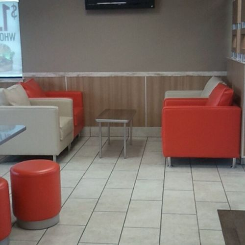 This is at a Burger King in Vegas. Really cool seating, plus a wall plug.