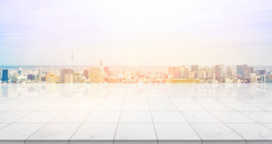 Business concept - Empty marble floor top with panoramic modern cityscape building bird eye aerial view under sunrise and morning blue bright sky of Tokyo skytree, Japan for display or montage product Architecture Building Exterior Building Feature Built Structure City Cityscape Day No People Outdoors Scenics Sky Skyscraper Skytree, Sky Tree, Stone, Tile, Empty, Marble, Rock, Floor, Ground, Nobody, Background, Mockup, Mock Up, Template, Display, Montage, Layout, Design, Texture, Blank, Japan, Tokyo, Cityscape, Landmark, Real Estate, Morning, Building, Skyline, Skyscraper, Bu Travel Destinations Urban Skyline