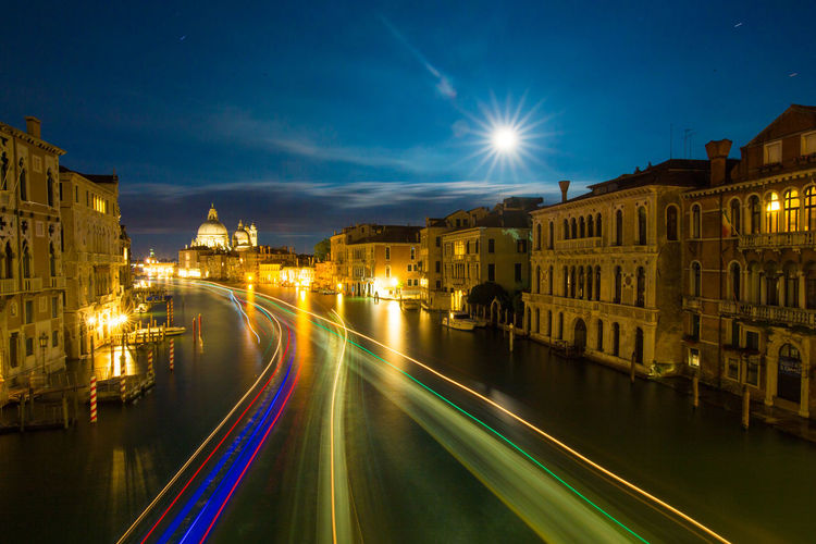 High angle view of light trails on grand canal by santa maria della salute at night