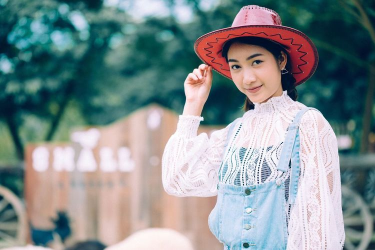 Young cowgirl EyeEm Selects Lifestyles One Person Portrait Outdoors Real People Smiling Looking At Camera Teenager Women Beauty Young Adult Beautiful People Fashion Tree Happiness Beautiful Woman Day Young Women Standing Beauty In Nature