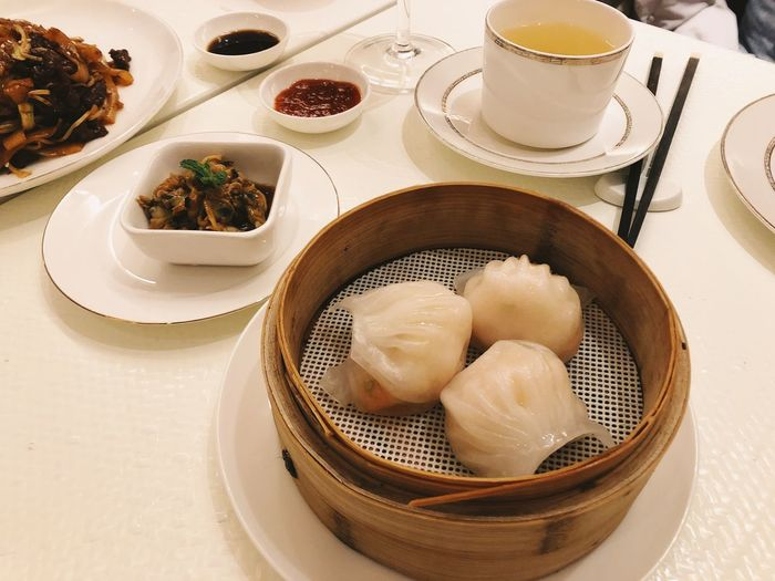 Food And Drink Food Freshness Dumpling  Table Ready-to-eat High Angle View Serving Size Indoors  Asian Food Chinese Dumpling Chinese Food Bowl Plate Dim Sum Steamed  Chinese New Year Chinese Eating Traditional Dinner Meal Tea Yummy Lifestyles